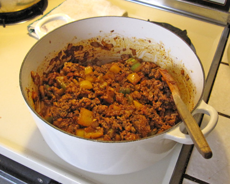 add your beef and brown, add your sausage and brown, stir into the vegetables