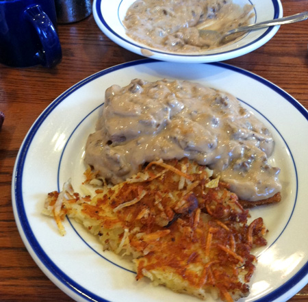 sausage gravy over corn meal mush, hash browns on the side