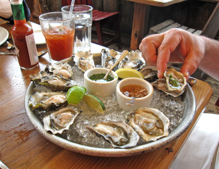 We started with oysters, 4 varieties, all from within five miles of here, then Eric got another platter for his main course