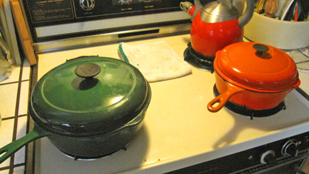 left to right: green le creuset, red teakettle, orange chicken-fryer