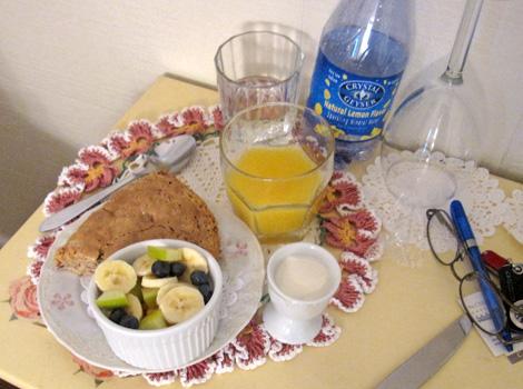 fruit cup, oatmeal scone, yogurt, orange juice