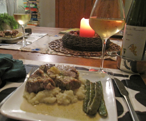 pork served with mashed potatoes and Romano beans.