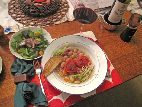 sardine with tomato salad served alongside beans and tomatoes